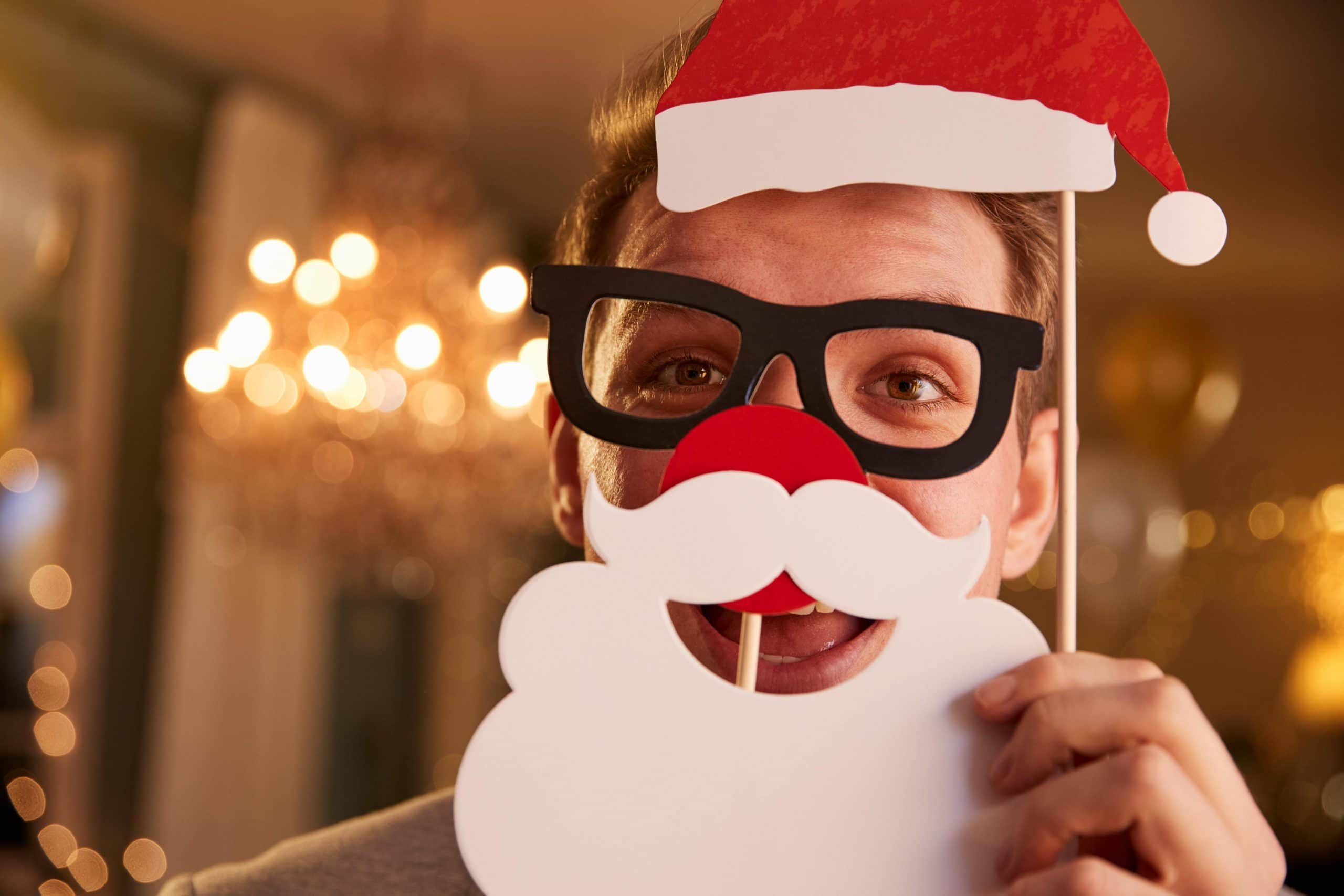 Young Man Dressing Up For Christmas Party
